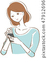 A woman who operates a smartphone 47912696
