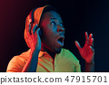 The young handsome hipster man listening music with headphones 47915701