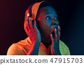 The young handsome hipster man listening music with headphones 47915703
