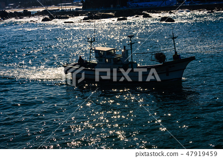 the silhouette of a jeweled sea and ship. 47919459