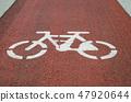 Bicycle lane signage on street 47920644