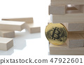 The bitcoin coin holds a game of wooden 47922601