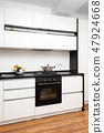 Modern classic black and white kitchen 47924668