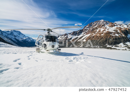Helicopter Landing on a Snow Mountain 47927452
