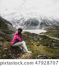 Mountain hiker traveling in wilderness landscape. 47928707