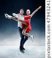 Professional man and woman figure skaters performing on ice show 47943241