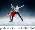 Professional man and woman figure skaters performing on ice show 47943260