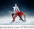 Professional man and woman figure skaters performing on ice show 47943266
