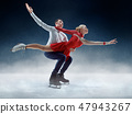Professional man and woman figure skaters performing on ice show 47943267