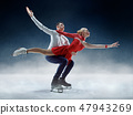 Professional man and woman figure skaters performing on ice show 47943269