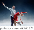Professional man and woman figure skaters performing on ice show 47943271