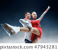Professional man and woman figure skaters performing on ice show 47943281