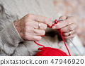 old caucasian woman knitting 47946920