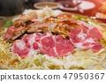 Slice pork grilled bbq on iron pan. 47950367