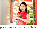 Asian woman in traditional Chinese dress in temple 47952647
