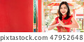 Asian woman in traditional Chinese dress in temple 47952648