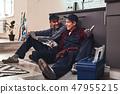 Little rest after hard work. Two handymen sitting on the floor 47955215