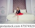 Little girl dressed as a ballerina in a tutu 47974929