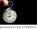Male hand hold stopwatch on a black background  47988431