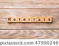 REFERRALS word written on wood block 47990246