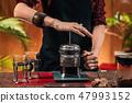 Barista  Making French Press Coffee 47993152