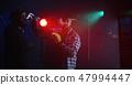 Film crew using a Fresnel lamp 47994447