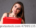 woman holding folder in hand 47995135