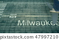 Aerial view of an airplane arriving to Milwaukee airport. Travel to United States 3D rendering 47997210