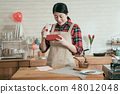 woman smiling looking her handmade sweet cocoa 48012048