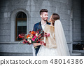 Happy romantic young couple celebrating their marriage 48014386