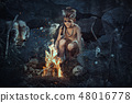 Shamans boy at the fire 48016778