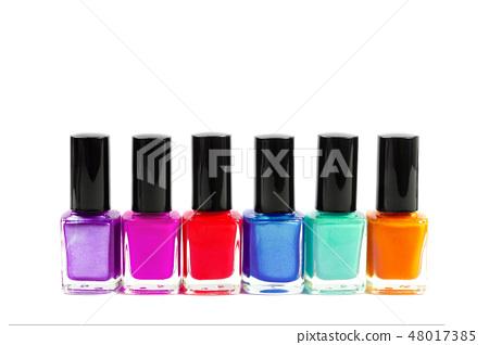 Set of colorful nail polish bottles isolated on white. 48017385