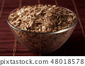 oat flakes in a glass bowl 48018578