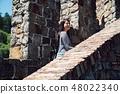 girl traveler visiting old medieval castle walk 48022340