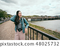 young girl relying resting hands on handrail 48025732