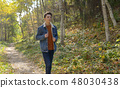 Teenager in the autumn path 48030438
