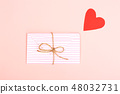 Envelope on pink background 48032731