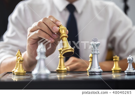 Planning and Strategic concept, Businessman playing chess and th 48040265