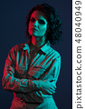 Girl studio portrait, red and blue contrast light 48040949