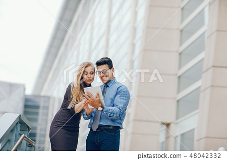 businessman in a summer city with woman 48042332