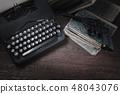 Crime fiction old retro vintage typewriter and gun 48043076