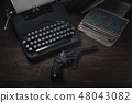 Crime fiction old retro vintage typewriter and gun 48043082