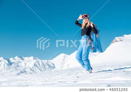 Portrait of woman in ski outfit. Portrait of cheerful blond woman at ski resort 48051293