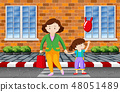 Mother and child crossing the road 48051489