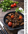 Roasted or stewed beef meat with tomato 48054982