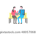 Male and female students sit on bench with book 48057068
