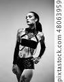 Tattooed woman wearing latex lingerie 48063959