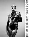 Tattooed woman wearing latex lingerie 48063960