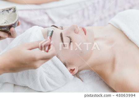 facial skin treatment with natural herbal in spa. 48063994