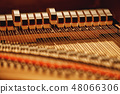 Inside of a piano. Close-up view of hammers and strings inside the piano. Musical instruments 48066306